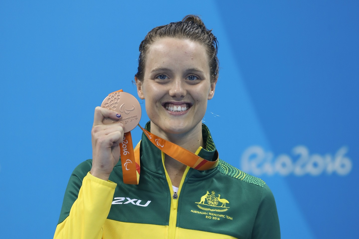 Bronze medalist Ellie Cole of Australia celebrates on the podium at the medal ceremony for the Womens 100m Freestyle - S9 Final during day 5 of the Rio 2016 Paralympic Games - Getty Images